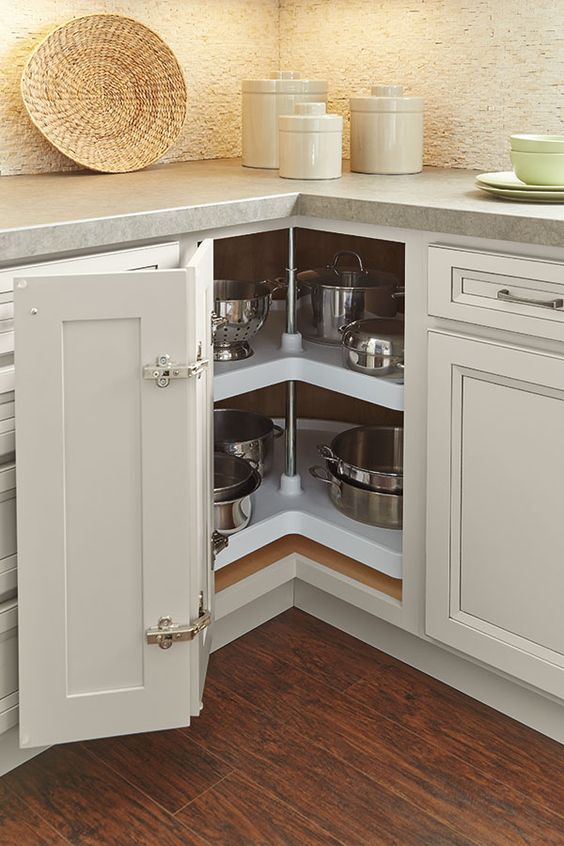 a neutral kitchen with a lazy susan cabinet that features a folding door is one of the best ideas to implement