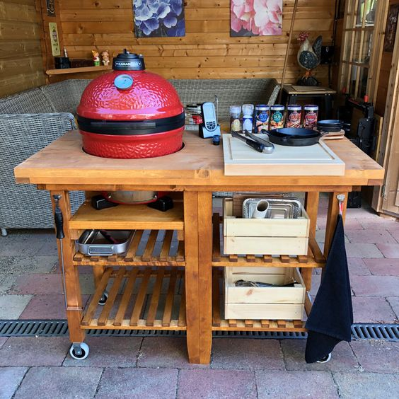 a rustic grill table composed of two IKEA Bekvam carts put under a single tabletop, with holders, drawers and boxes