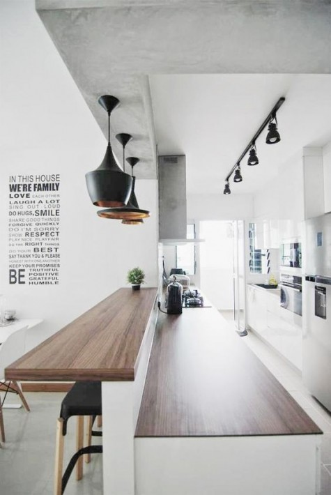 03 a kitchen island with a double countertop, a raised one is used as a breakfast or drink bar – a very smart idea to try