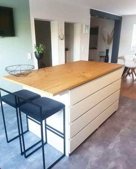 a modern kitchen island of a couple of IKEA Malm dressers is a cool space to cook and to have meals, too