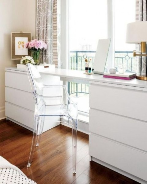 04 a modern white desk made of a couple of IKEA Malm dressers and a tabletop is a creative piece with plenty of storage