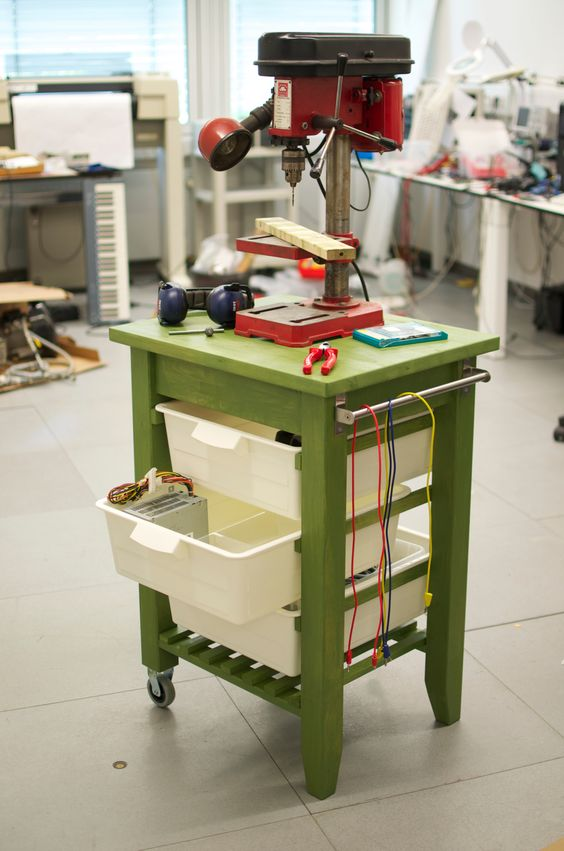 a green IKEA Bekvam cart makeover with holders and drawers, with cables is a cool solution for working