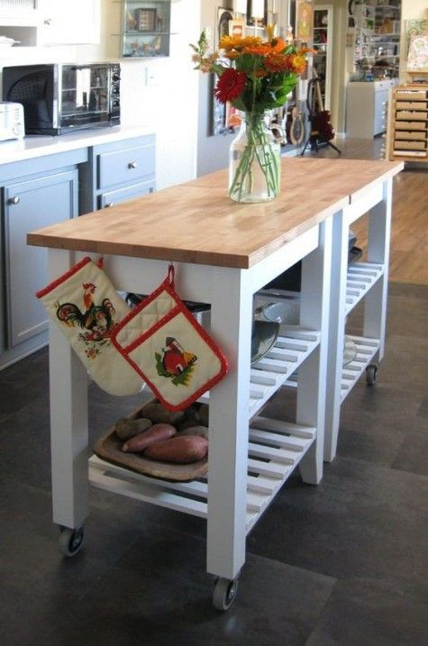 a kitchen island constructed of two IKEA Bekvam carts, butcherblock countertops is a very cool and mobile idea