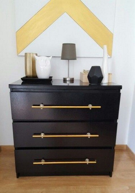 a black IKEA Malm dresser hack with long and elegant metallic handles is a very chic and cool idea