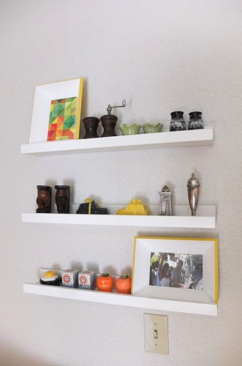 a floating kitchen storage unit made of three IKEA Ribba ledges is a lovely and fresh idea to rock