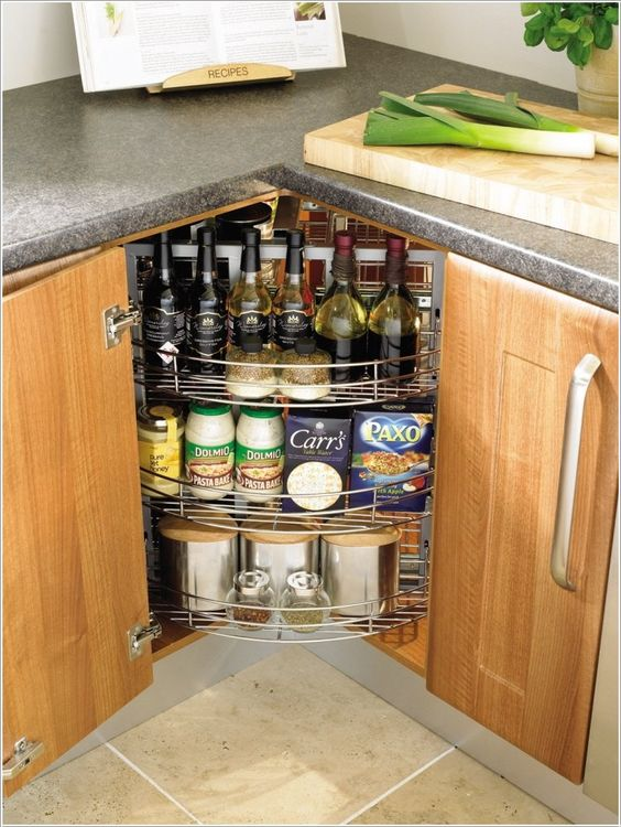 a lazy susan kitchen cabinet with three swivel compartments used for spices and wine is a smart idea
