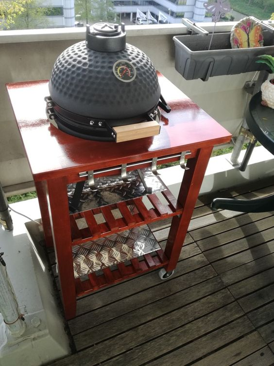 a rich-stained IKEA Bekvam cart makeover into a grill table with hooks and holders is a lovely piece for outdoor cooking