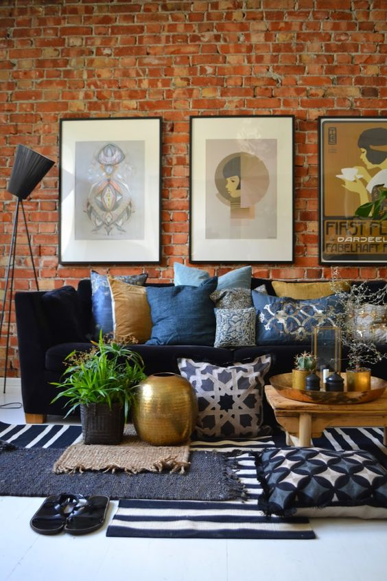 09 a beautiful living room with a brick wall, a navy Stockholm sofa, a gallery wall, printed textiles and some Moroccan touches