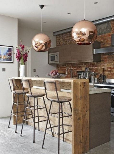 09 an industrial wooden bar attached to the kitchen island plus matching stools plus copper pendant lamps over it