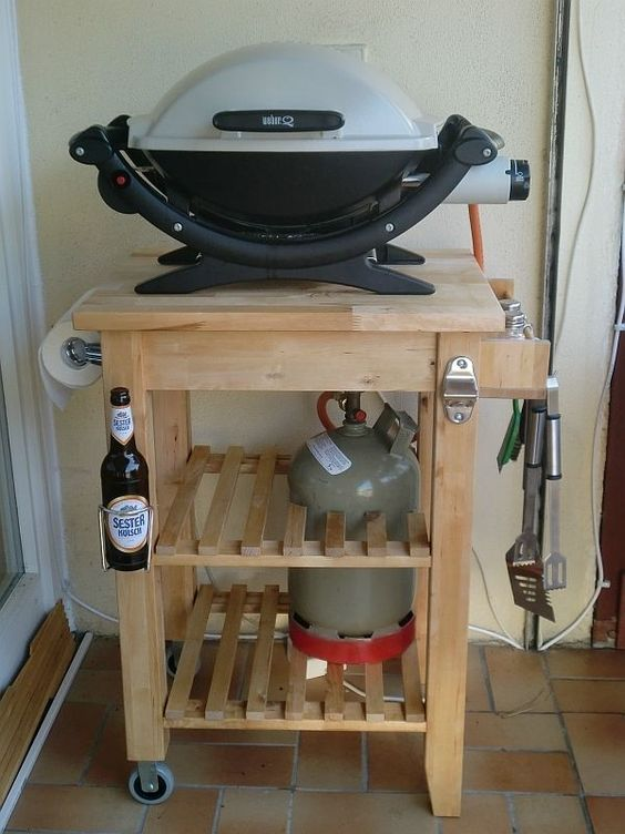 an IKEA Bekvam cart repurposed into a grill table with hangers and holders is a lovely idea for a rustic touch
