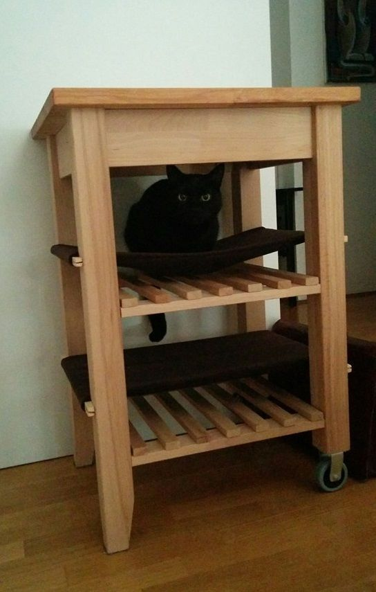 an IKEA Bekvam cart turned into a cat space with hammocks is a lovely piece for your furry friends