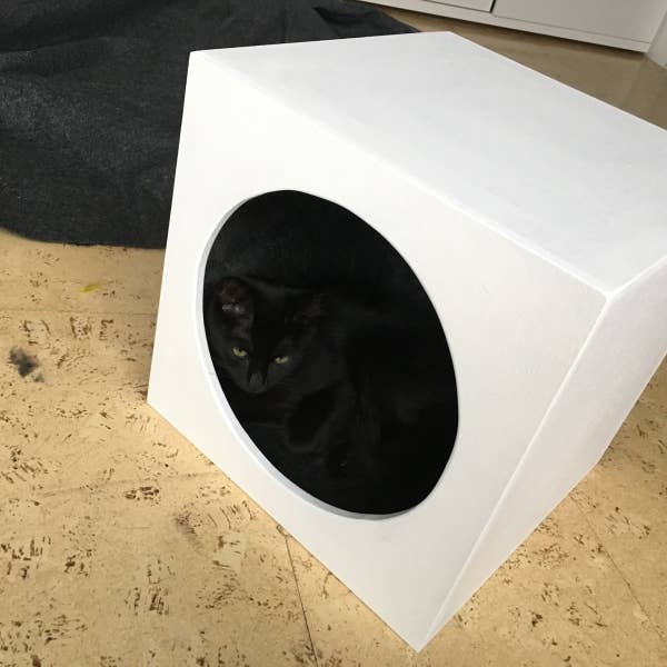 a small cat cavern will fit inside an Expedit or Kallax unit by IKEA, it looks modern and very fresh