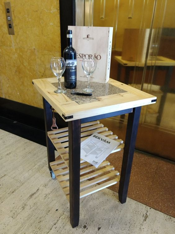 a beautiful IKEA Bekvam cart with navy paint, a wooden countertop and wooden slab shelves is a stylish idea