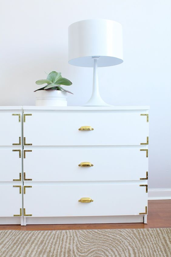 a chic IKEA Malm dresser hack with gold touches and pulls makes it look very sophisticated and super stylish