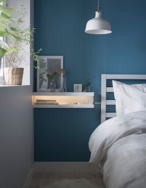a tiny floating nightstand with integrated light inside is made using IKEA Ribba ledges in white