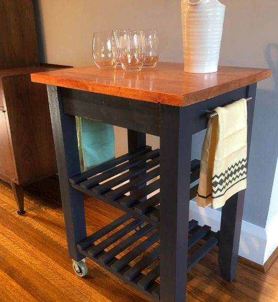 a bold IKEA Bekvam hack with graphite grey paint, a rich stained butcherblock countertop can be used in many kitchens