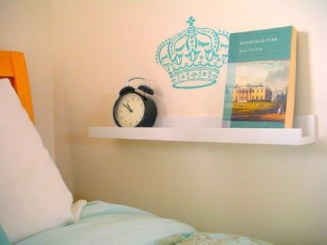 a very laconic nightstand with an IKEA Ribba ledge on the wall is a genius idea for a tiny bedroom