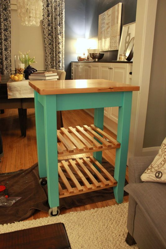 a bright and easy IKEA Bekvam cart painted turquoise and with a light stained countertop is a cool touch of color