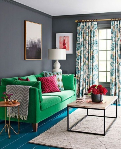 16 a cheerful bold green Stockholm sofa and a bold floor bring color to this moody space, and curtains add pattern here