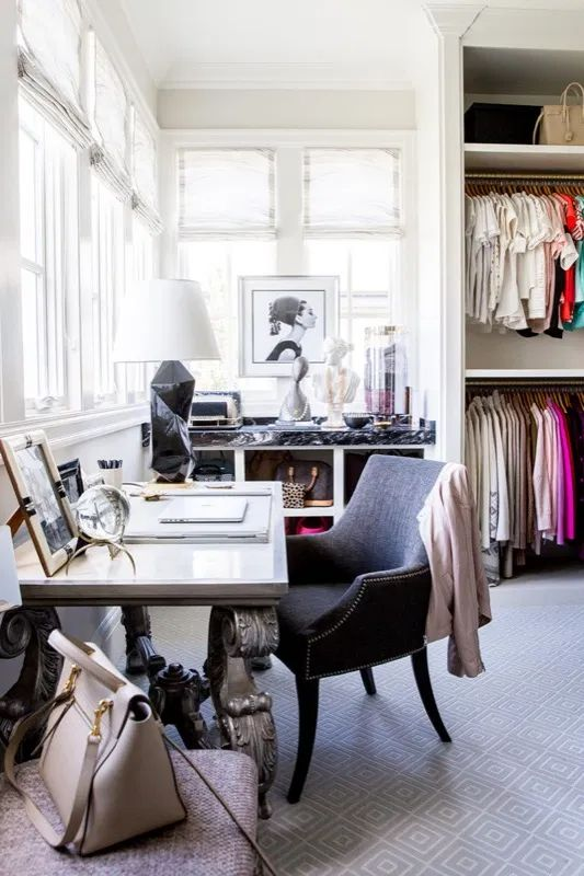 16 a chic and glam cloffice with clothes, accessories and shoes and a working space wiht a refined desk and a lovely chair