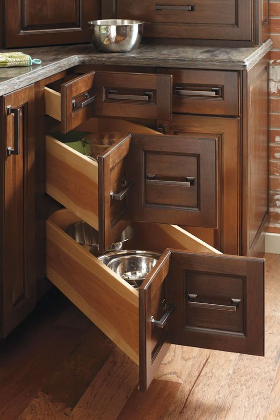 a dark stained kitchen with corner drawers is a stylish idea to store some stuff and make use of this dead space