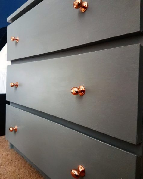 a grey IKEA Malm dresser with copper knobs is an elegant furniture piece that can be a nice idea for many spaces