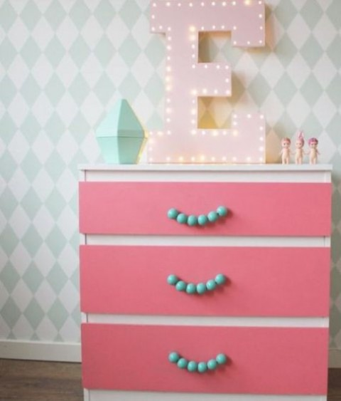 17 a pink IKEA Malm dresser done with self-adhesive paper and blue bead handles is a pretty addition to a girl's room