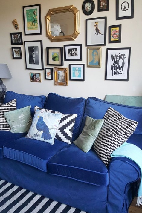 a gallery wall is a great addition to a wall above a sofa