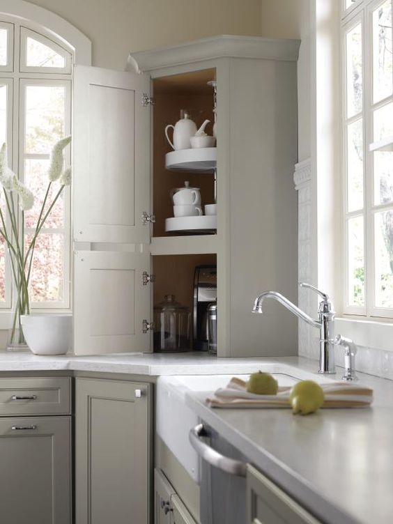 18 a dove grey farmhouse kitchen with a diagonal cabinet that includes swivel trays is a very smart idea