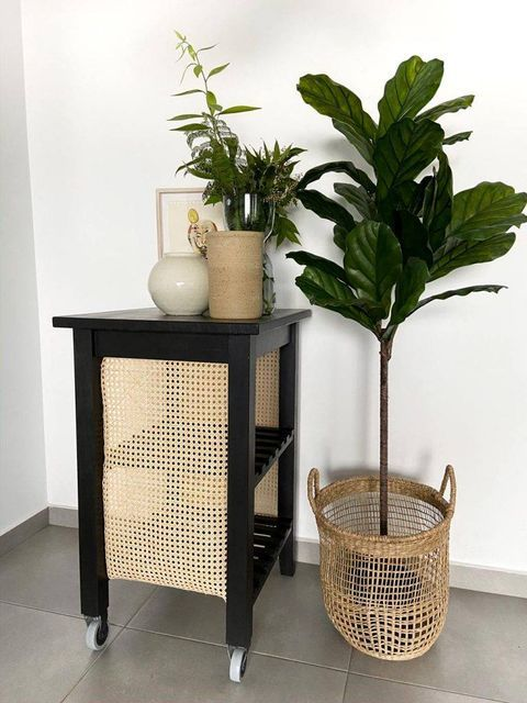 a gorgeous rustic IKEA Bekvam hack with black paint and rattan net is a super stylish solution for a modern space