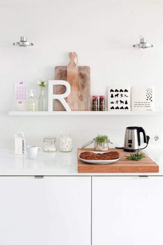 an IKEA Ribba ledge is an airy and lightweight idea to store and display things like here   kitchen stuff