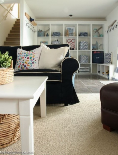 a customized black and white Ektorp sofa cover makes a statement in this neutral farmhouse living room