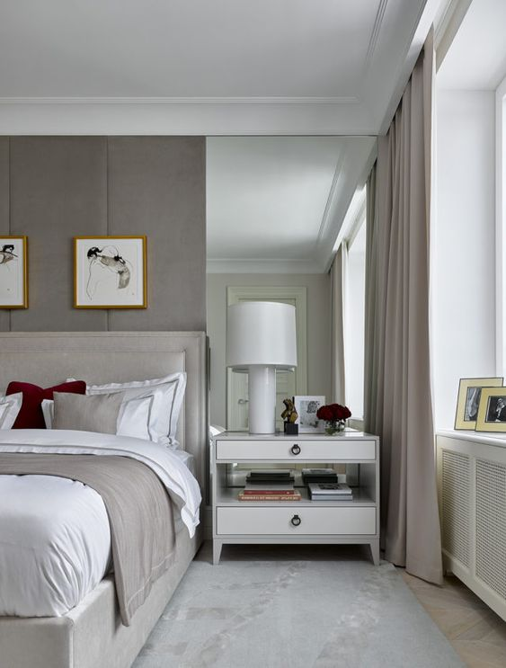 a narrow mirror strategically placed along the bed to make the space look large and a bit more narrow