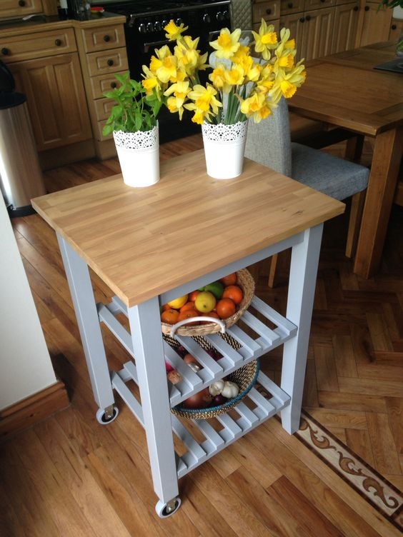 a pretty farmhouse IKEA kitchen cart hack with grey paint and a butcherblock countertop for a rustic kitchen