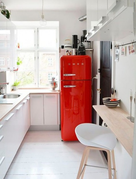 a small Scandinavian kitchen with a floating wooden breakfast or drink bar that can double as a cooking surface