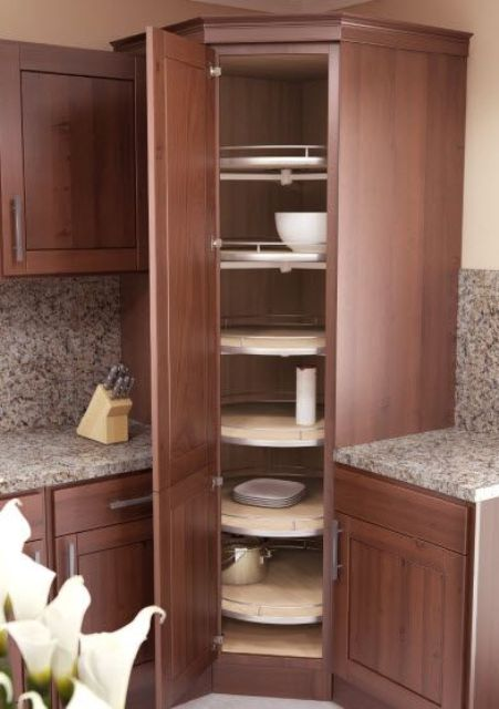 21 a stained diagonal cabinet with swivel trays is a very smart solution to store a lot of stuff here