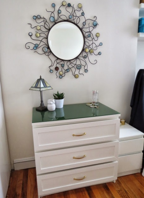 21 an IKEA Malm dresser hacked with new drawer fronts, gold handles and a black glass top looks very elegant and stylish