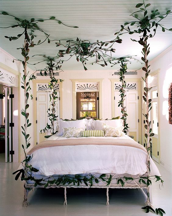 a creative bed with a bed frame created out of faux greenery is a lovely idea for a person who loves botanical decor