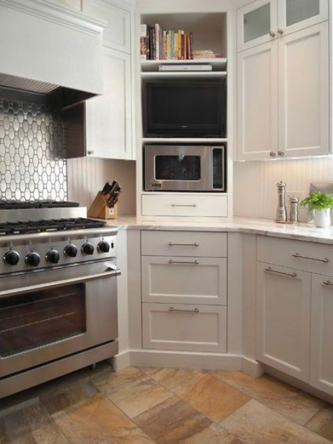 a series of diagonal cabinets, compartments and drawers is a lovely idea to make use of your corner space