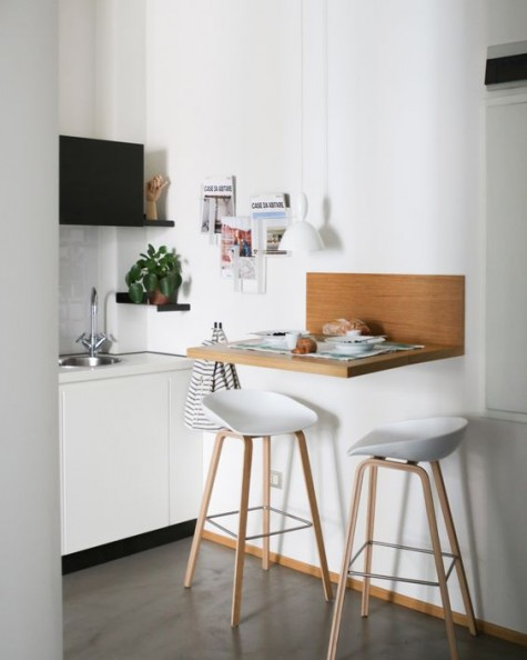 22 a tiny breakfast bar with a wooden floating tabletop and some comfy stools is a small and cozy idea for many kitchens