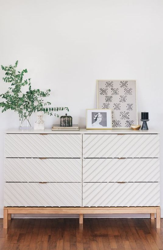 22 an IKEA Malm dresser hacked with overlays and extending legs on the frame looks chic and will match any modern room