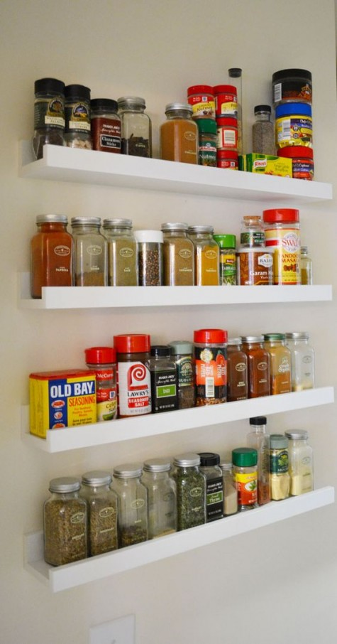 IKEA Ribba ledges with spices and other stuff for cooking is a very smart idea for a modern kitchen and such a hack won't take much time