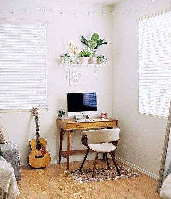 23 a tiny mid-century modern desk, a white upholstered chair, a shelf with potted plants for a working nook by the window