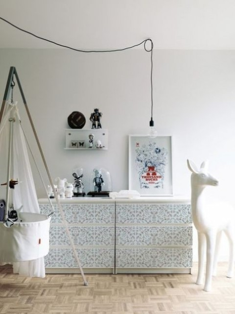 an IKEA Malm dresser hacked with printed blue and white wallpaper is a whimsical and quirky idea to try