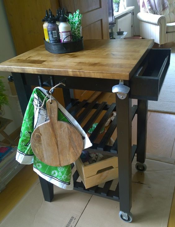 an IKEA Bekvam cart makeover with black paint and a butcherblock countertop, with an additional drawer and some hooks and holders