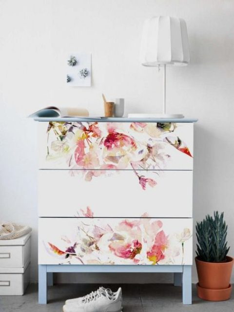 24 an IKEA Malm dresser with floral decals and on powder blue blue and top is a very romantic option