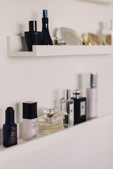 organize your makeup nook with IKEA Ribba ledges to store makeup, perfumes and other stuff you may need seamlessly