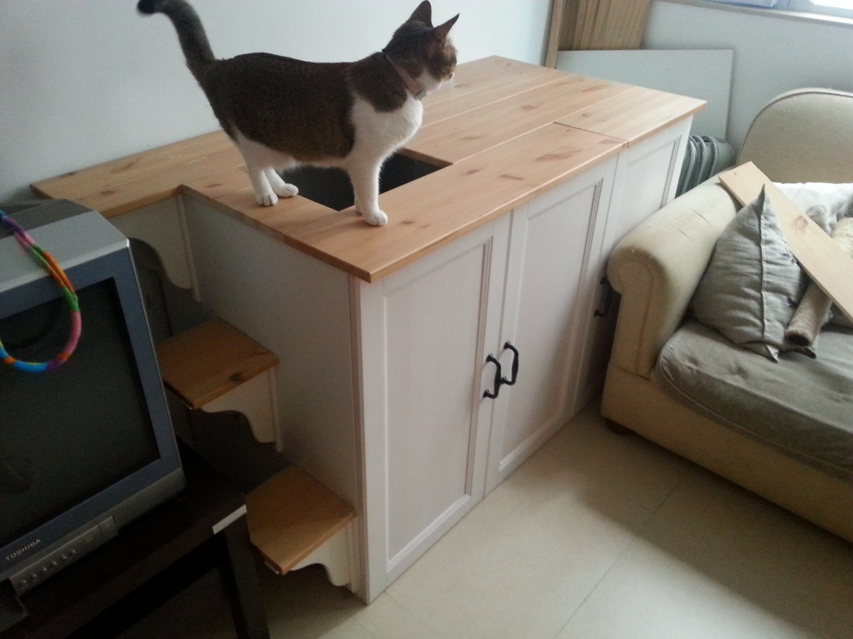 a stylish vintage-inspired kitty loo of an IKEA Metod cabinet is a lovely idea not to spoil your interior and achieve a chic look
