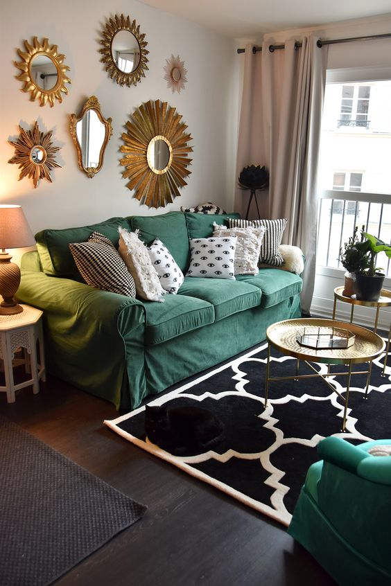 a whimsy living room with a green Ektorp sofa, a gallery wall of mirrors, Moroccan side tables and potted plants