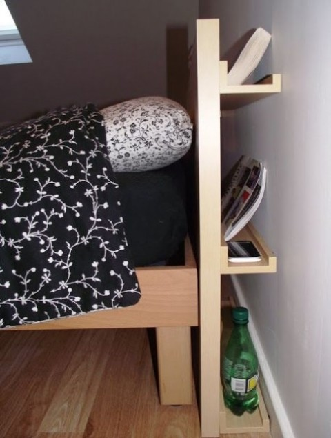 Ribba ledges attached to the back of the headboard create a lovely and smart storage unit that isn't seen